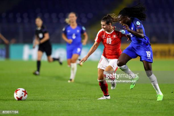 Ramona Bachmann of Switzerland and Griedge M'Bock Bathy of France compete for the ball during the Group C match between Switzerland and France during...