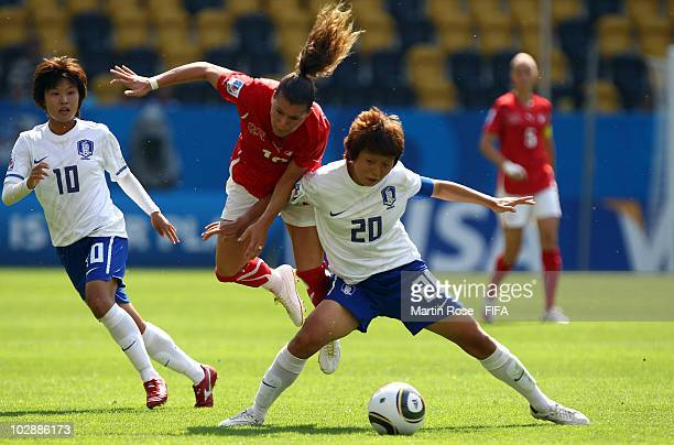 Ramona Bachmann of Switzerland and Ri Hye Kim of South Korea battle for the ball during the 2010 FIFA Women's World Cup Group D match between...
