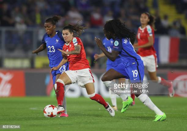 Ramona Bachmann of Switzerland battles with Grace Geyoro of France and Griedge M'Bock Bathy of France during the UEFA Women's Euro 2017 Group C match...