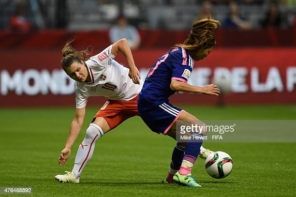 Ramona Bachmann of Switzerland challenges Rumi Utsugi of Japan during the FIFA Women's World Cup 2015 Group C match between Japan and Switzerland at...