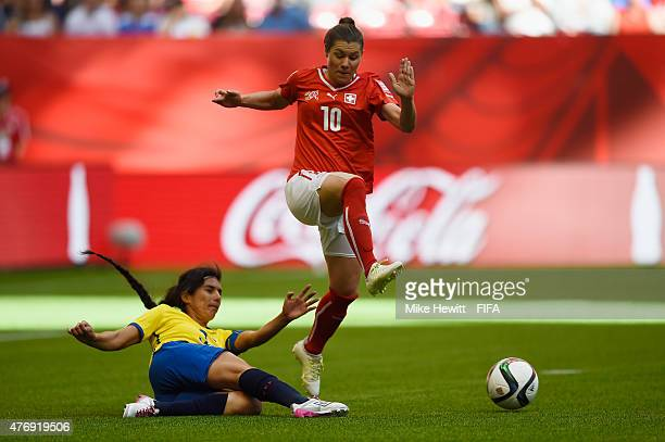 Ramona Bachmann of Switzerland gets away from Nancy Aguilar of Ecuador during the FIFA Women's World Cup 2015 Group C match between Switzerland and...