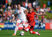 Ramona Bachmann of Switzerland is challenged by Jennifer Cramer of Germany during the women's international friendly match between Switzerland and...