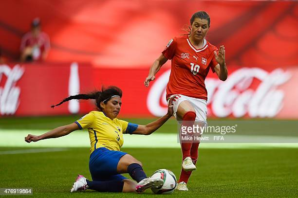 Ramona Bachmann of Switzerland is challenged by Nancy Aguilar of Ecuador during the FIFA Women's World Cup 2015 Group C match between Switzerland and...