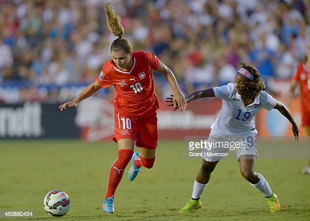 Ramona Bachmann of the Swiss women's national team battles for the ball with Crystal Dunn of the US women's national team during their match at...