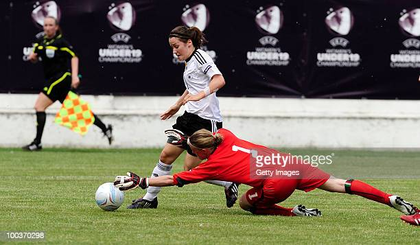 Ramona Petzelberger of Germany misses a chance against Katia Schroffenegger of Italy during the UEFA Women's Under19 European Championship group A...
