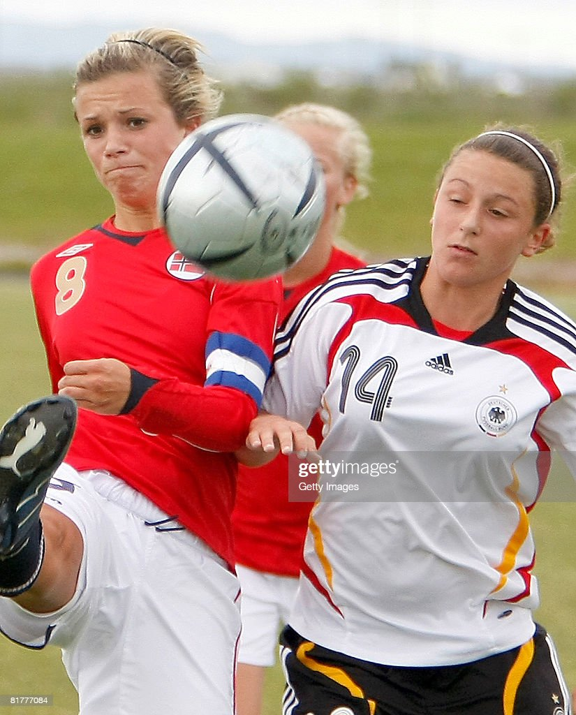 Ramona Petzelberger of Germany tries to get the ball from Cathrine Deckerhus of Norway during the U16 Nordic Cup match between Norway and Germany at the Hvolsvollur stadium on June 30, 2008 in Hvolsvoellur, Iceland.