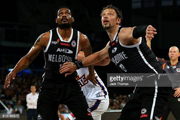 Ramone Moore and David Anderson of Melbourne United box out during the round three NBL match between Melbourne United and Brisbane Bullets at Hisense...