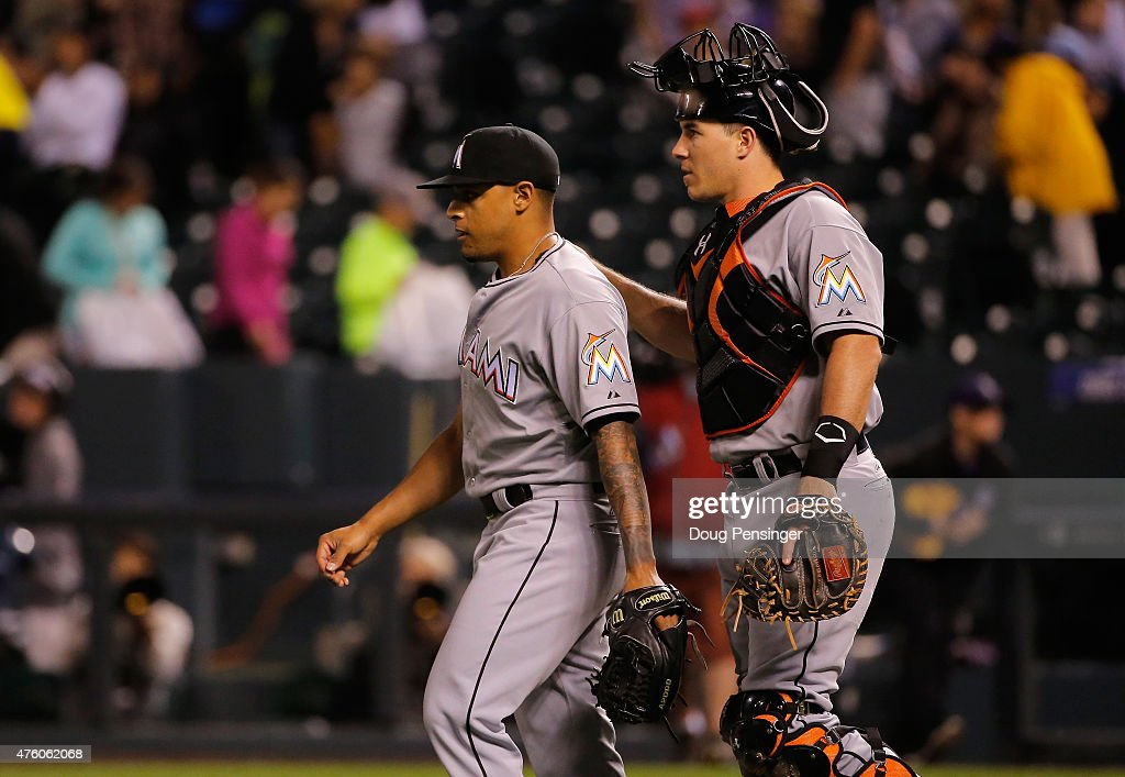 A.J. Ramos #44 and J.T. Realmuto #20 of the Miami Marlins celebrate their 6-2 victory over the Colorado Rockies at Coors Field on June 5, 2015 in Denver, Colorado.