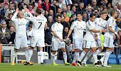Ramos and Ronaldo of Real Madrid celebrate their team's score with their team mates during the La Liga match between Real Madrid and Malaga at...