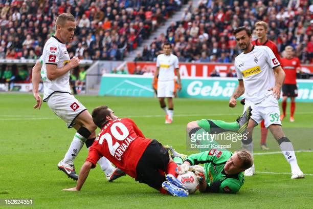 Ramos Carjaval of Leverkusen attacks MarcAndre ter Stegen of Moenchengladbach during the Bundesliga match between Bayer 04 Leverkusen and Borussia...