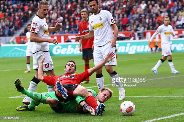 Ramos Carjaval of Leverkusen falls over MarcAndre ter Stegen of Moenchengladbach during the Bundesliga match between Bayer 04 Leverkusen and Borussia...