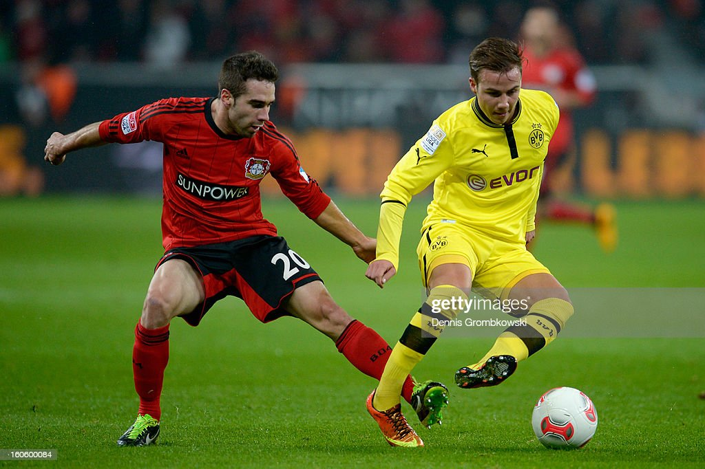 Ramos Carvajal of Leverkusen challenges <a gi-track='captionPersonalityLinkClicked' href=/galleries/search?phrase=Mario+Goetze&family=editorial&specificpeople=4251202 ng-click='$event.stopPropagation()'>Mario Goetze</a> of Dortmund during the Bundesliga match between Bayer 04 Leverkusen and Borussia Dortmund at BayArena on February 3, 2013 in Leverkusen, Germany.