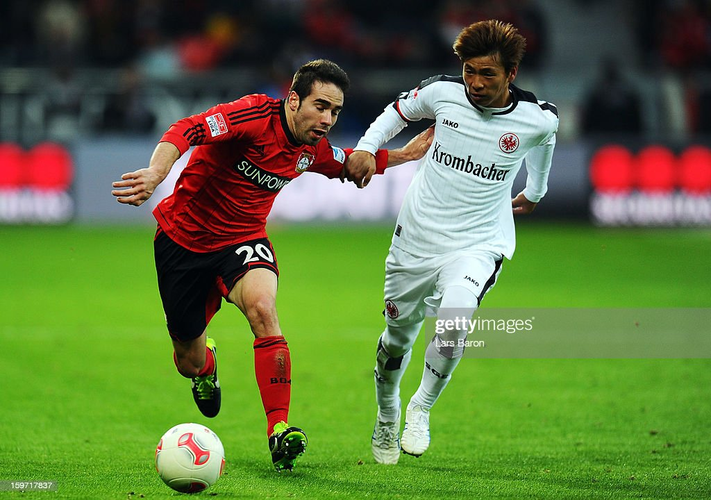 Ramos Carvajal of Leverkusen is challenged by <a gi-track='captionPersonalityLinkClicked' href=/galleries/search?phrase=Takashi+Inui&family=editorial&specificpeople=7174976 ng-click='$event.stopPropagation()'>Takashi Inui</a> of Frankfurt during the Bundesliga match between Bayer 04 Leverkusen and Eintracht Frankfurt at BayArena on January 19, 2013 in Leverkusen, Germany.