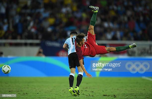 Ramos Chico of Portugal and Cristian Espinoza of Argentina collide during the Men's Group D first round match between Portugal and Argentina during...