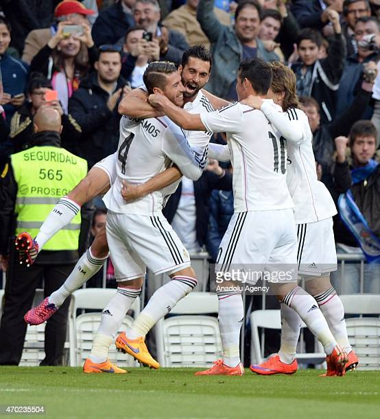 Ramos of Real Madrid and his team mates celebrate their team's score during the La Liga match between Real Madrid and Malaga at Estadio Santiago...