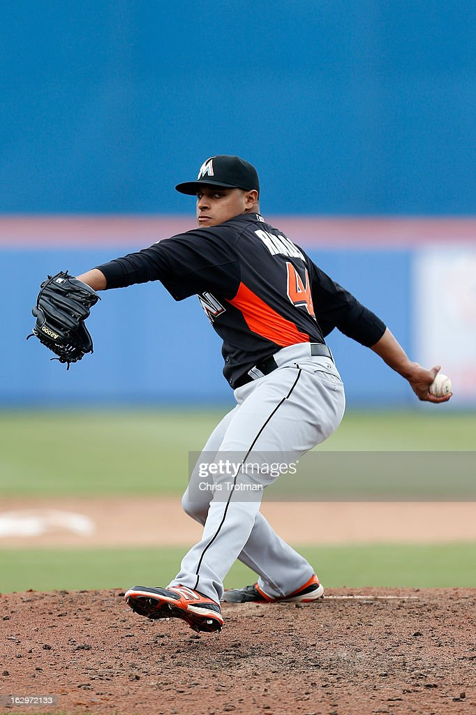 A.J. Ramos #44 of the Miami Marlins pitches against the New York Mets at Tradition Field on March 2, 2013 in Port St. Lucie, Florida.