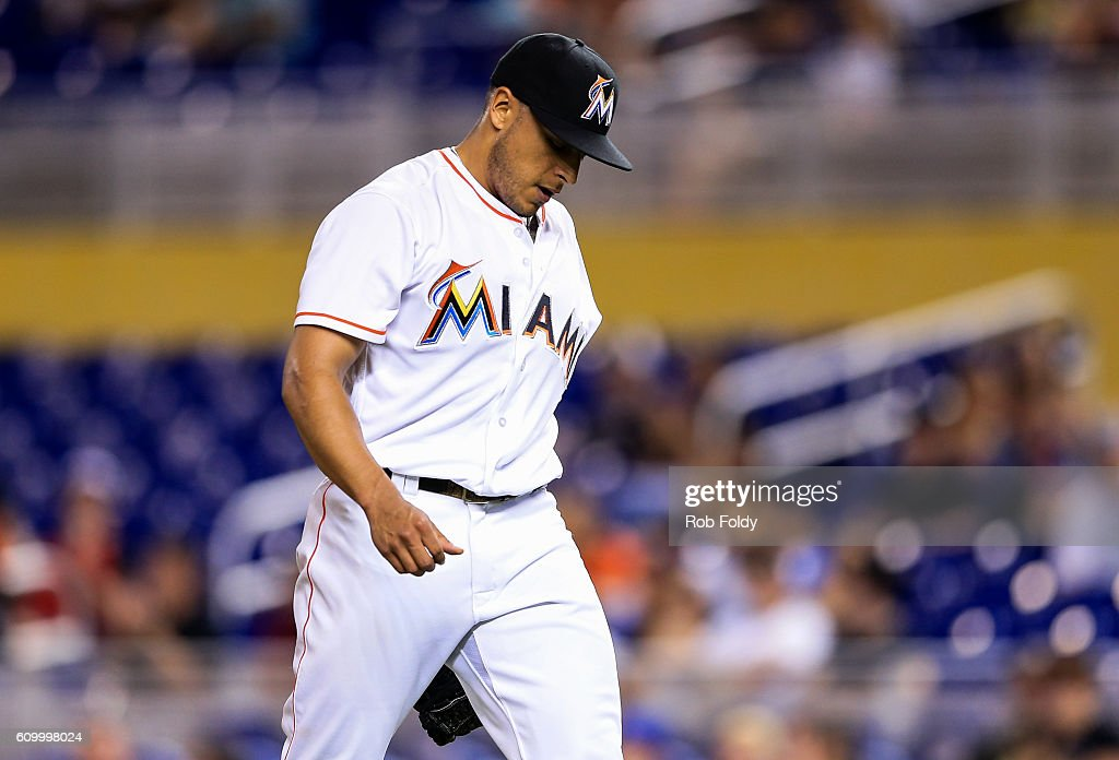 A.J. Ramos #44 of the Miami Marlins walks off the field during the ninth inning of the game against the Atlanta Braves at Marlins Park on September 23, 2016 in Miami, Florida.
