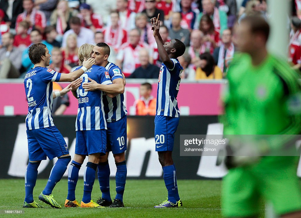 Ramos Vasquez (R) of Berlin celebrates with team mates after scoring his team's first goal during the Bundesliga match between FC Bayern Muenchen and Hertha BSC Berlin at Allianz Arena at Allianz Arena on October 26, 2013 in Munich, Germany.