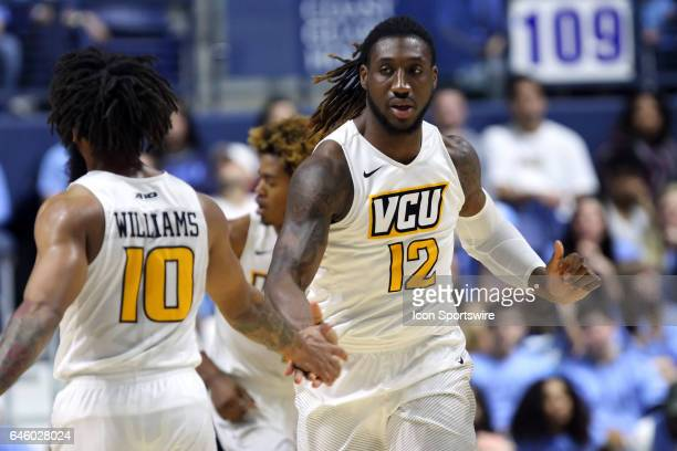 Rams guard Jonathan Williams and VCU Rams forward Mo AlieCox reacts after a scored basket during the first half of a college basketball game between...