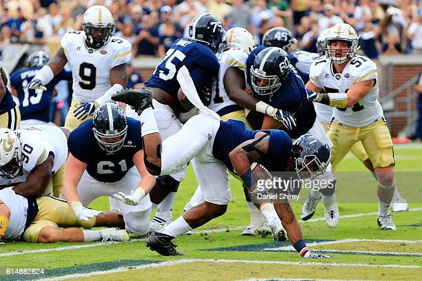 A Ramsby of the Georgia Southern Eagles scores a touchdown during the first half against the Georgia Tech Yellow Jackets at Bobby Dodd Stadium on...