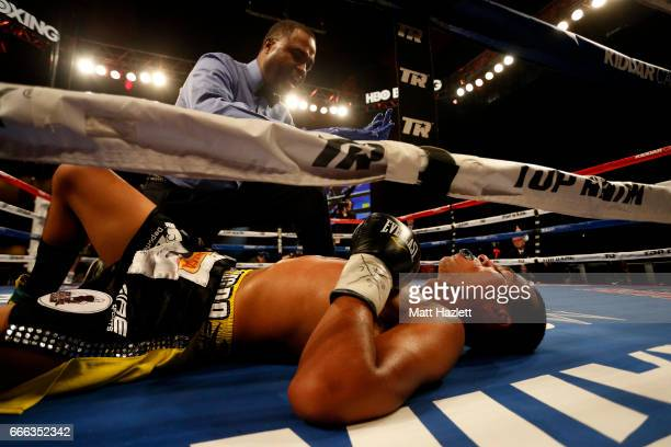 Ramses Agaton of Mexico lays on the mat after being defeated by Egidijus Kavaliauskas of Lithuania in their Welterweight bout at The Theater at MGM...