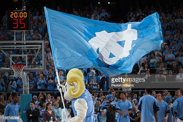 Ramses mascot of the North Carolina Tar Heels waves a flag with the UNC logo before a game against the Wisconsin Badgers on November 30 2011 at the...