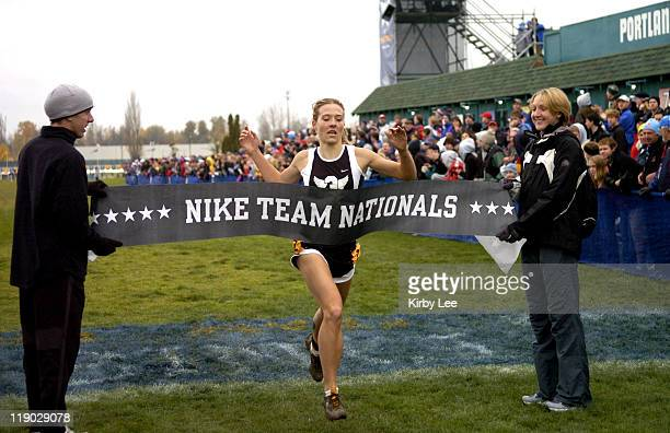 Ramsey Kavan of Yankton SD crosses breaks the finish tape held by Alan Webb and Paula Radcliffe to win the girls race in 1805 in the Nike Team...