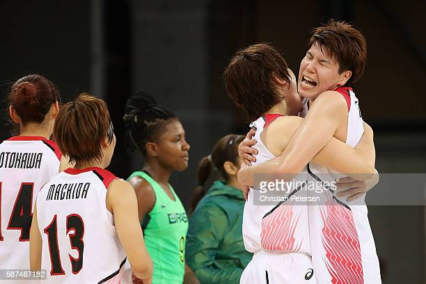 Ramu Tokashiki and Maki Takada of Japan celebrate after defeating Brazil in the women's basketball game on Day 3 of the Rio 2016 Olympic Games at the...