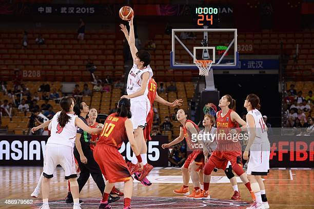 Ramu Tokashiki of Japan and Hongpin Huang of China compete for the ball in finals match between Japan and China during the 2015 FIBA Asia...