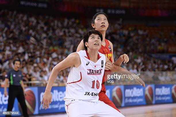 Ramu Tokashiki of Japan and Hongpin Huang of China react in finals match between Japan and China during the 2015 FIBA Asia Championship for Women at...