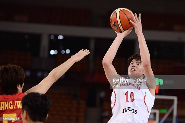 Ramu Tokashiki of Japan shoots in finals match between Japan and China during the 2015 FIBA Asia Championship for Women at Wuhan Sports Center...