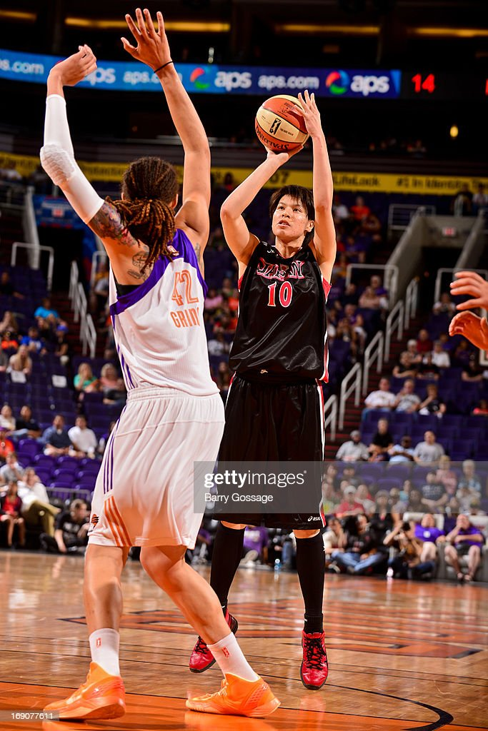 Ramu Tokashiki #10 of the Japanese National Team shoots against Brittney Griner #42 of the Phoenix Mercury during a WNBA preseason game on May 19, 2013 at U.S. Airways Center in Phoenix, Arizona.