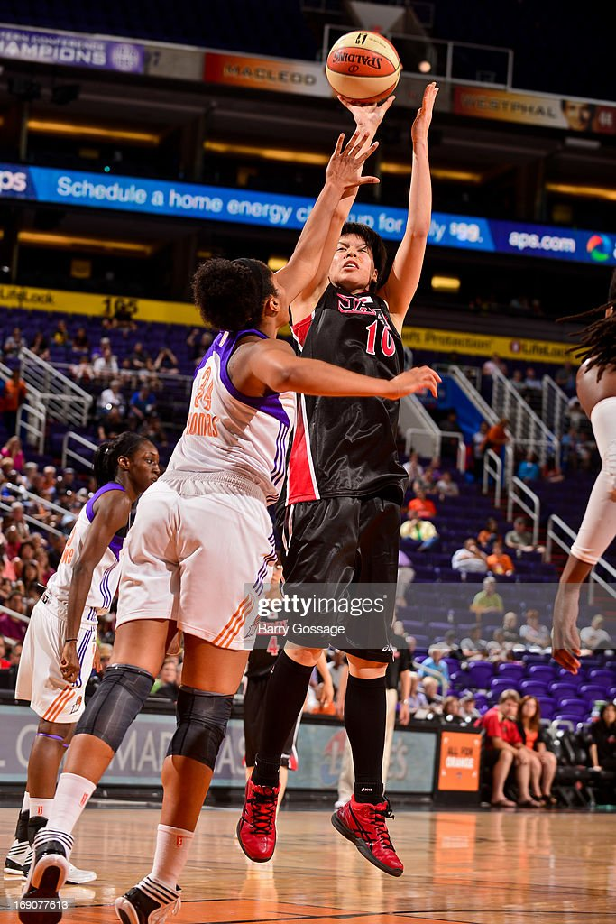 Ramu Tokashiki #10 of the Japanese National Team shoots against Krystal Thomas #34 of the Phoenix Mercury during a WNBA preseason game on May 19, 2013 at U.S. Airways Center in Phoenix, Arizona.