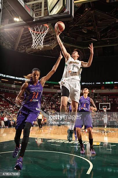 Ramu Tokashiki of the Seattle Storm goes to the basket against the Phoenix Mercury on June 21 2015 at KeyArena in Seattle Washington NOTE TO USER...