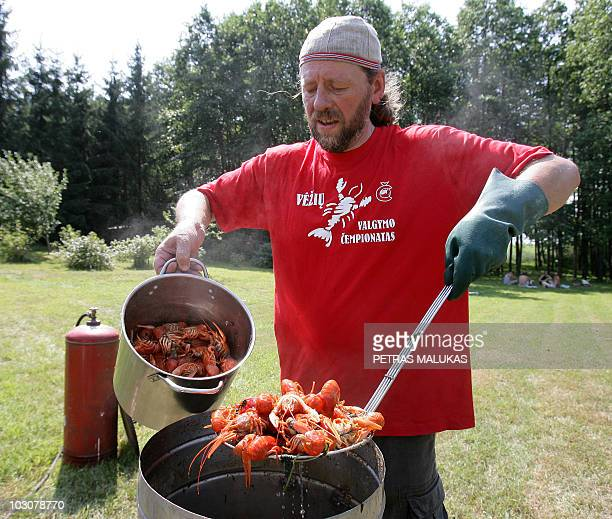 Ramunas Cizas organizer of the Crayfish Eating Competition boils crayfishes in a big tub on 24 July 2010 in Dusetos 160kms from Vilnius AFP PHOTO /...