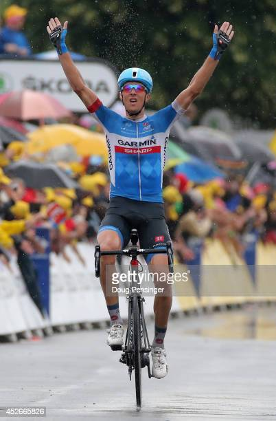 Ramunas Navardauskas of Lithuania and GarminSharp celebrates as he crosses the finish line to win the nineteenth stage of the 2014 Tour de France a...