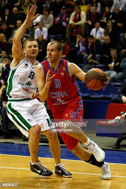 Ramunas Siskauskas #9 of CSKA Moscow competes with Rimantas Kaukenas #13 of Montepaschi Siena in action during the Euroleague Basketball Last 16 Game...