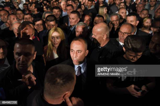 Ramush Haradinaj joined by the supporters of the 'war wing' coalition celebrate their victory in Pristina early on June 12 2017 The coalition's...