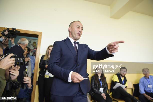 Ramush Haradinaj prime minister candidate and leader of the Alliance for Future of Kosovo gestures at a polling station in Pristina during early...