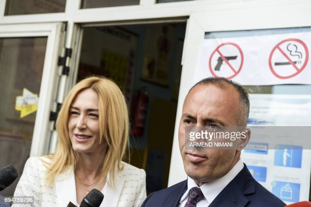 Ramush Haradinaj prime minister candidate and leader of the Alliance for Future of Kosovo speaks to the press next to his wife Anita after voting at...