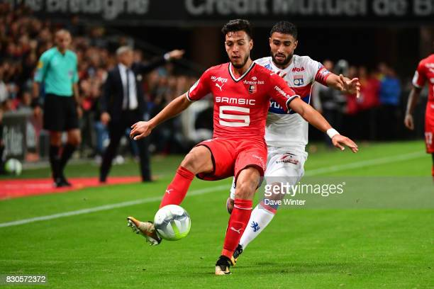 Ramy Bensebaini of Rennes and Nabil Fekir of Lyon during the Ligue 1 match between Stade Rennais and Olympique Lyonnais at Roazhon Park on August 11...
