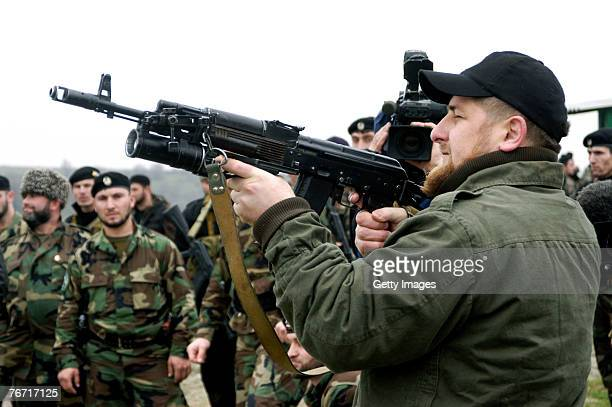 TSENTEROI CHECHNYA RUSSIA NOVEMBER 2005 Ramzan Kadyrov proudly displays his shooting skills at a firing range in his village of Tsentoroi in front of...