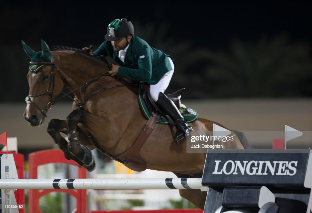 Ramzy Al Duhamy of Saudi Arabia clears a hurdle on Bayard Van de Villa Theresia during the President of the UAE Showjumping Cup - Furusyiah Nations Cup Series presented by Longines on February 21, 2013 in Al Ain, United Arab Emirates.