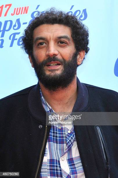 Ramzy attends the Des Lendemains Qui Chantent Paris Premiere during Day 6 of the Champs Elysees Film Festival on June 16 2014 in Paris France