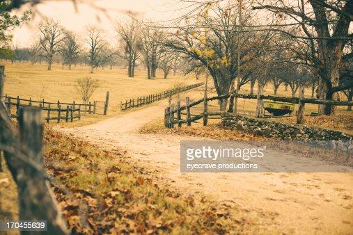 Ranch Dirt Road and Split Rail Fence Overcast Sky