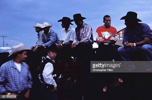 Ranch hands 'Cowboys' await their moment to enter the arena on the back of a bull or horse to show off their skills