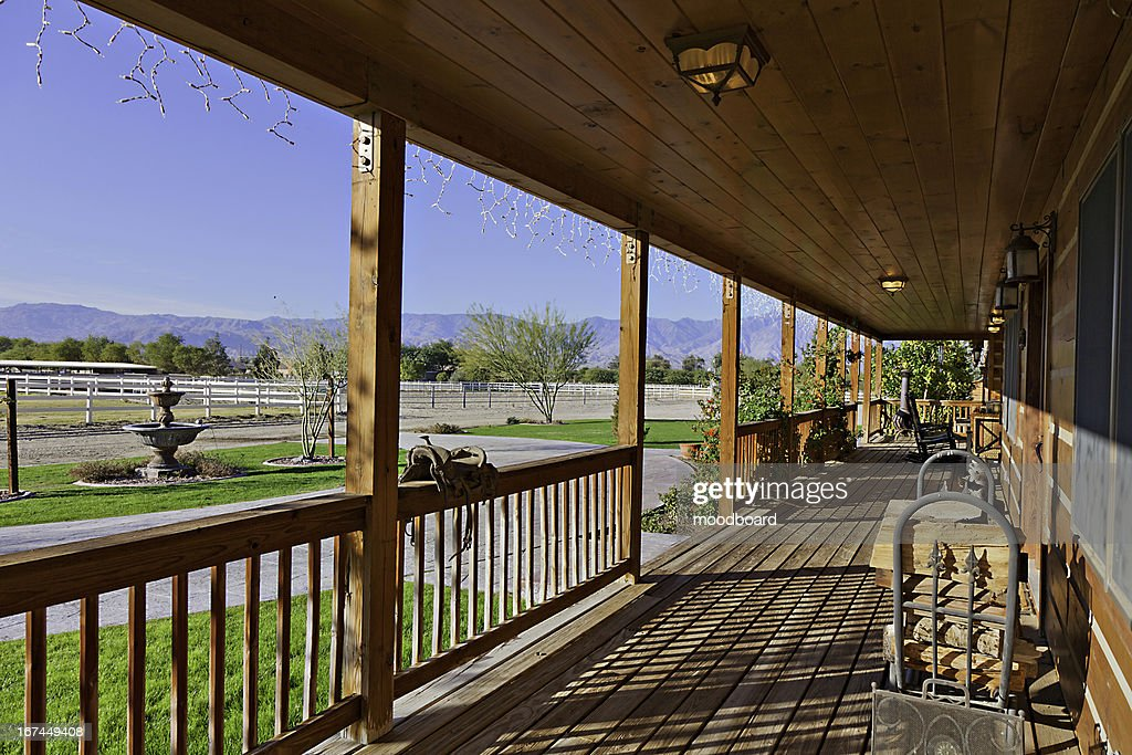 Ranch porch overlooking horse stables : Stock Photo