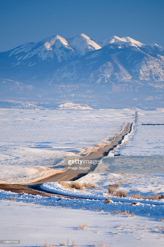 Ranch road in winter, La Sal Mountains, Utah, USA : Stock Photo