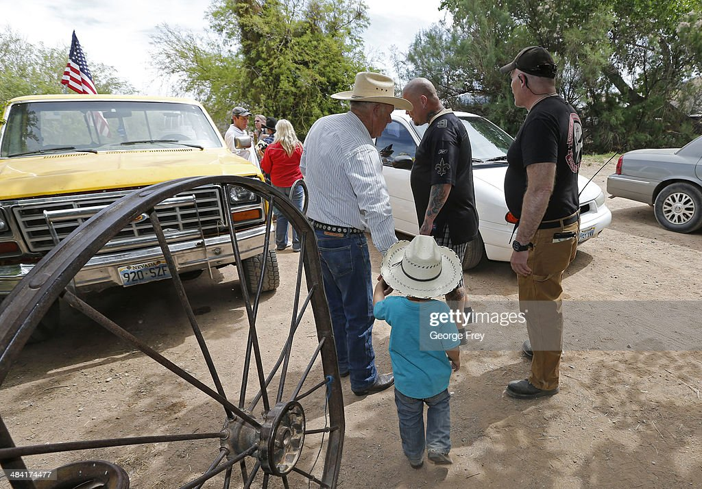 Rancher Cliven Bundy with his grandson in tow and armed security leave his ranch house on April 11, 2014 west of Mesquite, Nevada. Bureau of Land Management officials are rounding up Cliven Bundy's cattle, he has been locked in a dispute with the BLM for a couple of decades over grazing rights. (Photo by George Frey/Getty Images
