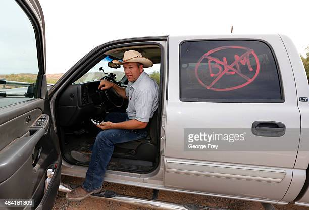 Rancher Cliven Bundy's son Ammon Bundy talks on a cell phone in his truck on April 11 2014 west of Mesquite Nevada Bureau of Land Management...